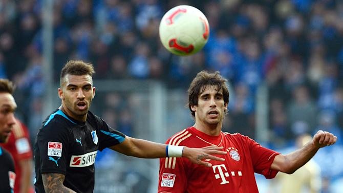 Munich's Javier Martinez, right, and Hoffenheim's Daniel Williams challenge for the ball during the German first division Bundesliga soccer match between TSG 1899 Hoffenheim and FC Bayern Munich in Sinsheim, Germany, March 3, 2013. (AP Photo/dpa, Daniel Maurer)