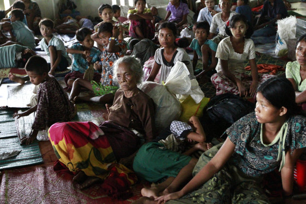 Local residents take refuge in a monastery compound in Sittwe, the capital of Rakhine state in western Myanmar, where sectarian violence continues to impact the public, Wednesday, June 13, 2012. Heavy