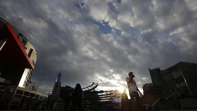Fans arrive for the NFL football AFC Championship football game between the New England Patriots and Baltimore Ravens in Foxborough, Mass., Sunday, Jan. 20, 2013. (AP Photo/Matt Slocum)