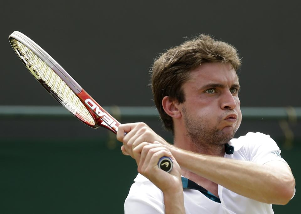 Gilles Simon of France returns a shot to Xavier Malisse of Belgium during a second round men's singles match at the All England Lawn Tennis Championships at Wimbledon, England, Thursday, June 28, 2012. (AP Photo/Alastair Grant)