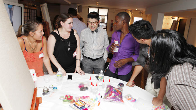 COMMERCIAL IMAGE - Fashion Designer Mondo Guerra helps I Design launch attendees with a design challenge at the launch of I Design, his new national HIV campaign in collaboration with Merck on Tuesday, July 17, 2012 in New York, NY.  I Design encourages meaningful and open physician-patient dialogue that takes into account a person's medical and lifestyle needs.  For more information and to design a digital textile illustrating your approach to managing HIV, visit www.ProjectIDesign.com. (Photo by Amy Sussman/Invision for Merck/AP Images)