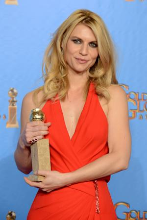 """Actress Claire Danes poses with the award for best performance by an actress in a television series - drama for """"Homeland"""" backstage at the 70th Annual Golden Globe Awards at the Beverly Hilton Hotel on Sunday Jan. 13, 2013, in Beverly Hills, Calif. (Photo by Jordan Strauss/Invision/AP)"""