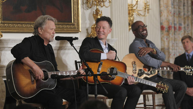 From left, Kris Kristofferson, Lyle Lovett, and Darius Rucker, perform during an interactive student workshop on the history of Country music hosted by first lady Michelle Obama, Monday, Nov. 21, 2011,  in the State Dinning Room of the White House in Washington. (AP Photo/Pablo Martinez Monsivais)