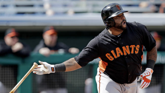 San Francisco Giants' Pablo Sandoval hits a double during the third inning of an exhibition spring training baseball game against the Chicago Cubs Sunday, Feb. 24, 2013, in Mesa, Ariz. (AP Photo/Morry Gash)