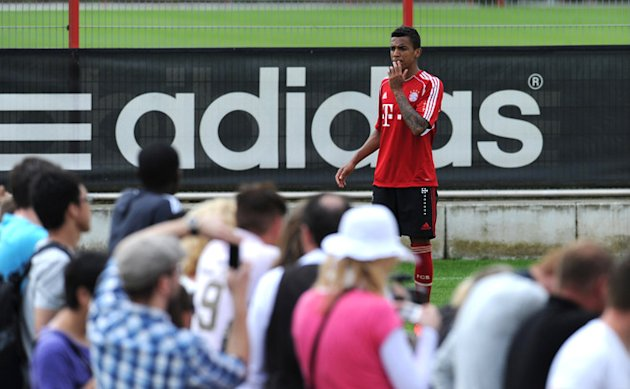 Bayern Munich's Brazil Defender Luiz Gustavo Arrives To Sign Autographs For Fans  AFP PHOTO / CHRISTOF STACHECHRISTOF AFP/Getty Images