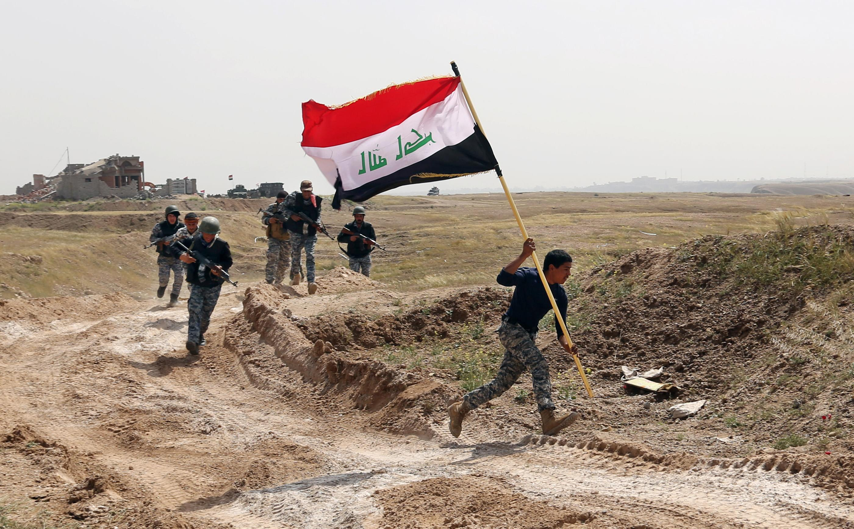 AP PHOTOS: Iraqi forces struggle to take back Tikrit