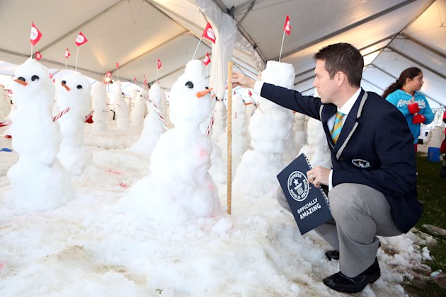 IMAGE DISTRIBUTED FOR MATTEL - Snowmen in Southern California are measured in an attempt to break the Guinness World Record for most snowmen built in one hour at Mattel Headquarters on Thurs., Dec. 13