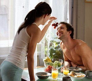 couple eating breakfast, happy and playful