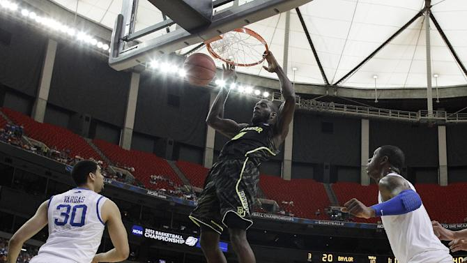 Baylor's Quincy Acy (4) dunks the ball as Kentucky's Darius Miller, right, and Kentucky's Eloy Vargas look on during the first half of an NCAA tournament South Regional finals college basketball game Sunday, March 25, 2012, in Atlanta. (AP Photo/John Bazemore)