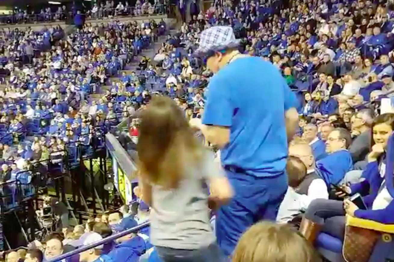 A Kentucky fan tried to crotch-slide down a railing while holding another fan and it went horribly wrong