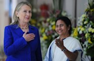 US Secretary of State Hillary Clinton talks with West Bengal's chief minister Mamata Banerjee at the Writers' Building in Kolkata. Clinton has urged India to further cut its imports of Iranian oil, saying that the Islamic republic posed a major threat if it developed nuclear weapons
