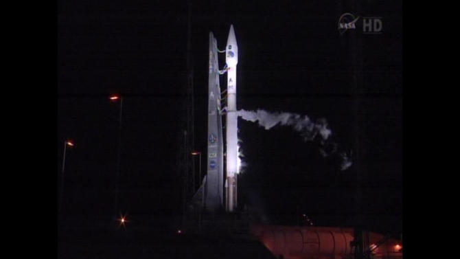 This framegrab image provided by NASA-TV shows the Atlas V first stage and Centaur upper stage sitting on the launch pad at Cape Canaveral Air Force Station, Florida just prior to launch being scrubbed for the day early Saturday Aug. 25, 2012. The planned launch is scheduled for 4:07 a.m. EDT Sunday of NASA's Radiation Belt Storm Probes. The Atlas V burns refined kerosene fuel, known as RP-1, mixed with liquid oxygen. The Centaur uses liquid hydrogen for fuel, mixed with liquid oxygen. The Centaur will ignite after the Atlas V first stage burns its propellants and falls away. (AP Photo/NASA)