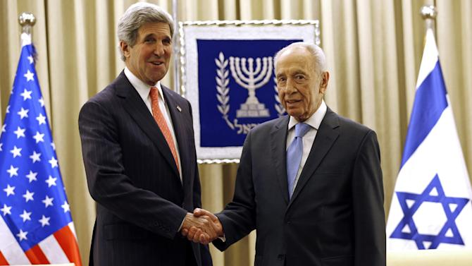U.S. Secretary of State John Kerry meets with Israeli President Shimon Peres in Jerusalem, Israel, Thursday, May 23, 2013. The US and Israel raised hopes Thursday for a restart of the Middle East peace process, despite little tangible progress so far from Kerry's two-month-old effort to get Israelis and Palestinians back to the negotiating table.  (AP Photo/Jim Young, Pool)