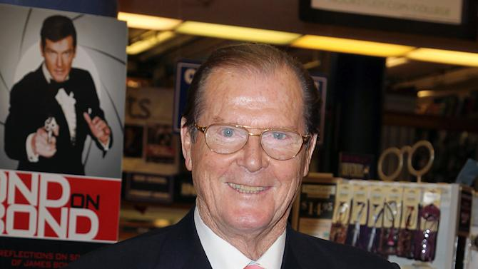 "FILE - This Nov. 9, 2012 file image released by Starpix shows British actor Roger Moore at a signing for his book, ""Bond On Bond: Reflections on 50 years of James Bond Movies,"" at Barnes and Noble in New York. Moore's recollections are cheeky and well informed. He includes snapshots of famous pals who showed up on set, details gadgetry and includes a great color beefcake shot of Daniel Craig. Moore, who was one of six actors who portrayed the super spy James Bond 007, starred in the films, ""Live and Let Die,"" ""A View to a Kill,"" ""Octopussy,"" ""Moonraker,"" ""The Man with the Golden Gun,"" ""For Your Eyes Only,"" and ""The Spy Who Loved Me.""  (AP Photo/Starpix, Amanda Schwab)"