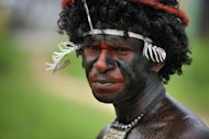 A Papuan tribesman participates in the Lake Sentani festival in the Jayapura district of the eastern Indonesian province of Papua. The island of New Guinea that encompasses Papua New Guinea and Indonesian Papua is a vast reservoir of languages in a world where languages of various tribal groups are disappearing quietly, according to anthropologists