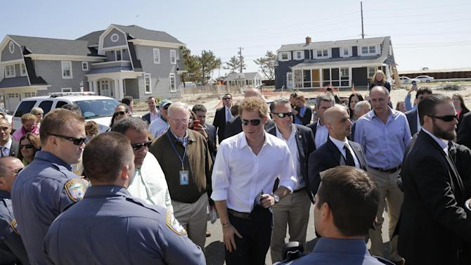 Britain's Prince Harry, center, talks to people during a visit an area hit by Superstorm Sandy, Tuesday, May 14, 2013, in Seaside Heights, N.J. New Jersey sustained about $37 billion worth of damage from the storm. (AP Photo/Mel Evans, Pool)