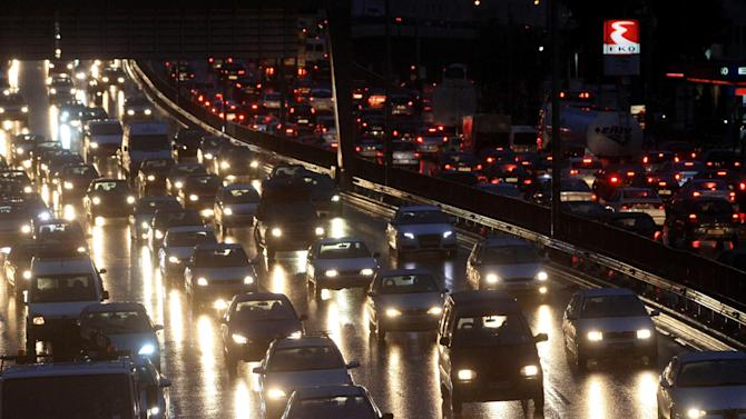 Cars are caught in a traffic jam during a strike by metro workers in Athens, late Thursday, Jan. 24, 2013. Greece's conservative prime minister is holding emergency meeting after a deadline for striking public transport workers expired, leaving Athens' subway system closed for an eighth day. Strikers protesting pay cuts refused to return to work Thursday despite a court decision declaring their protest illegal. Greek riot police stormed the Athens subway train depot early Friday to enforce a government emergency order forcing striking metro workers back to work in an escalating standoff over new austerity measures. (AP Photo/FOSPHOTOS, Panagiotis Tzamaros)