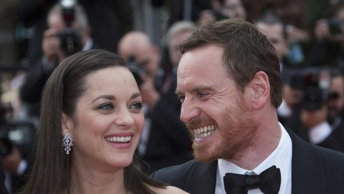 "Cast members Marion Cotillard and Michael Fassbender pose on the red carpet as they arrive for the screening of the film ""Macbeth"" in competition at the 68th Cannes Film Festival in Cannes"