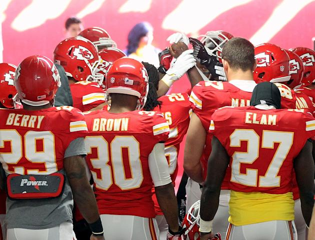 KANSAS CITY, MO - DECEMBER 02: Kansas City Chiefs players huddle in prayer in the tunnel to the field prior to the game against the Carolina Panthers at Arrowhead Stadium on December 2, 2012 in Kansas