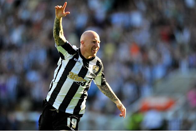 Lee Hughes scored a late winner for table-toppers Notts County