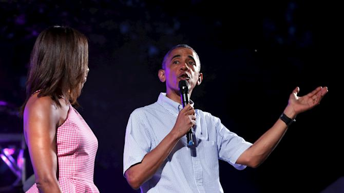U.S. President Barack Obama and First lady Michelle Obama greet military families and guests for an Independence Day celebration on the South Lawn of the White House in Washington