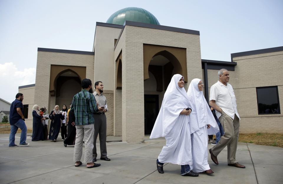 Worshipers leave the Islamic Center of Murfreesboro after midday prayers on Friday, Aug. 10, 2012, in Murfreesboro, Tenn. Opponents of  the mosque waged a two-year court battle trying to keep it from opening. (AP Photo/Mark Humphrey)
