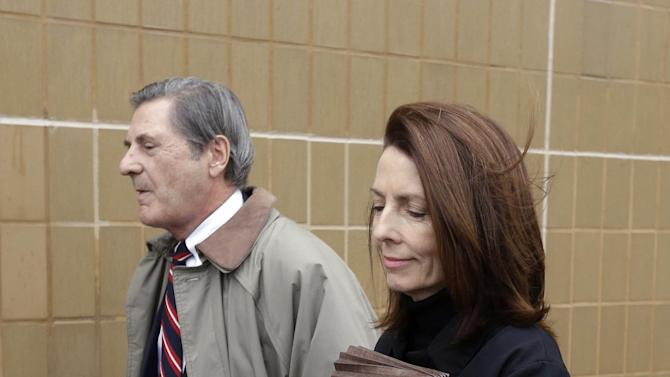 FILE--In this Jan. 29, 2013 file photo, former Michigan Supreme Court Justice Diane Hathaway leaves federal court in Ann Arbor, Mich., with her husband, Michael Kingsley, after pleading guilty to bank fraud. A judge deciding a punishment for a former Michigan Supreme Court justice has two very different recommendations in front of him. Diane Hathaway is returning to Ann Arbor federal court Tuesday for her sentence for bank fraud. She misled a bank and hid assets while trying to negotiate a short sale on her home in Grosse Pointe Park. (AP Photo/Carlos Osorio)
