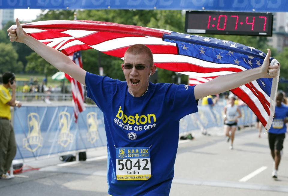 Collin Matthews, of Danvers, Mass., finishes the Boston Athletic Association 10k in Boston, Sunday, June 23, 2013. More than 6,400 runners took part in Boston's first major race since the April marathon bombings that killed three people and injured hundreds of others. (AP Photo/Michael Dwyer)