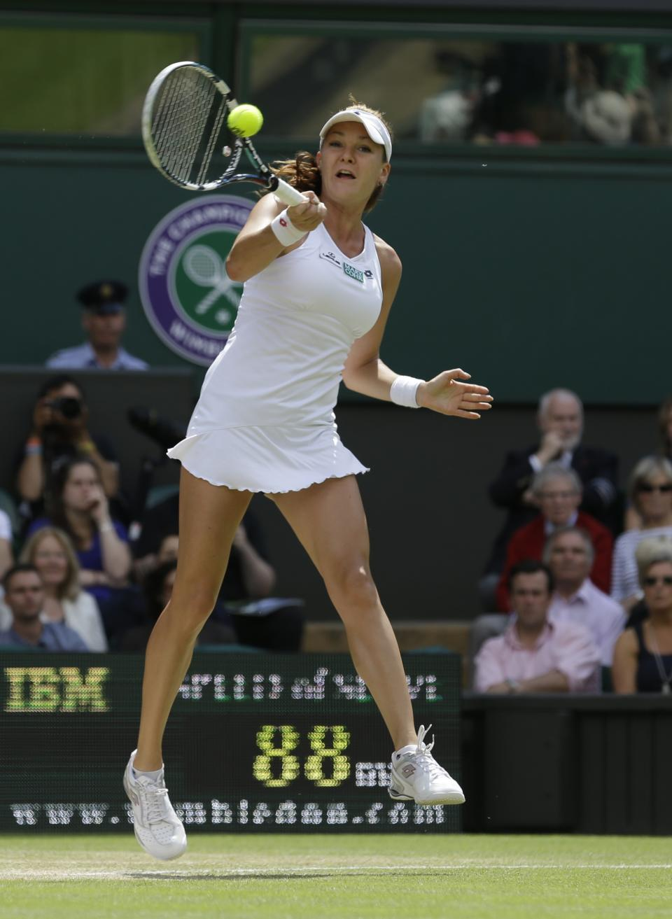 Agnieszka Radwanska of Poland plays a shot to Angelique Kerber of Germany during a semifinals match at the All England Lawn Tennis Championships at Wimbledon, England, Thursday, July 5, 2012. (AP Photo/Anja Niedringhaus)