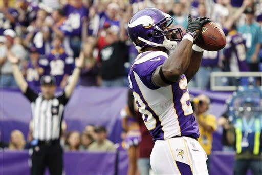 Peterson returns, Vikings edge Jaguars 26-23 in OT