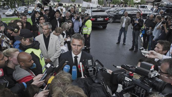 Norwegian Prime Minister Jens Stoltenberg, right, speaks to the media in Sundvollen, Norway Saturday July 23, 2011. A Norwegian gunman disguised as a police officer beckoned his victims closer before shooting them one by one, claiming at least 84 lives, in a horrific killing spree on an idyllic island teeming with youths that has left this peaceful Nordic nation in mourning. The island tragedy Friday unfolded hours after a massive explosion ripped through a high-rise building housing the prime minister's office, killing seven people. (AP Photo/ScanpixAleksander Andersen / Scanpix