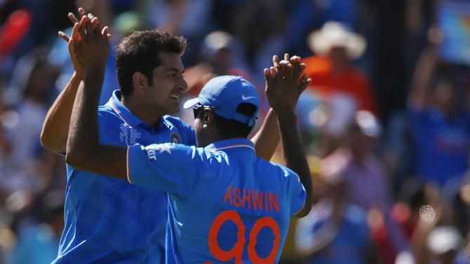 India's Mohit Sharma celebrates with team mate Ravichandran Ashwin after Sharma caught out West Indies batsman Chris Gayle for 21 runs during their Cricket World Cup match in Perth