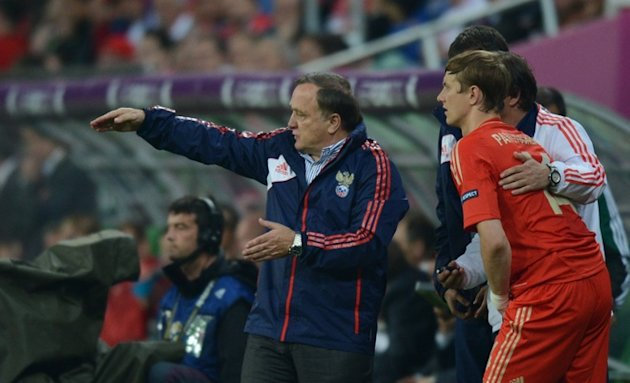 Russian Forward Roman Pavlyuchenko (R)  Listens AFP/Getty Images