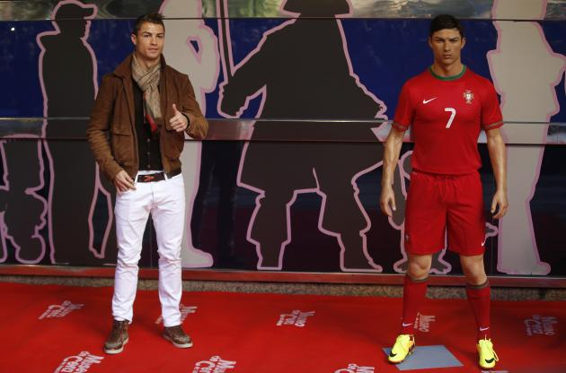 Cristiano Ronaldo, who plays for Real Madrid and Portugal's national soccer team, poses with his wax statue after an unveiling ceremony at the Madrid Wax Museum, in Madrid