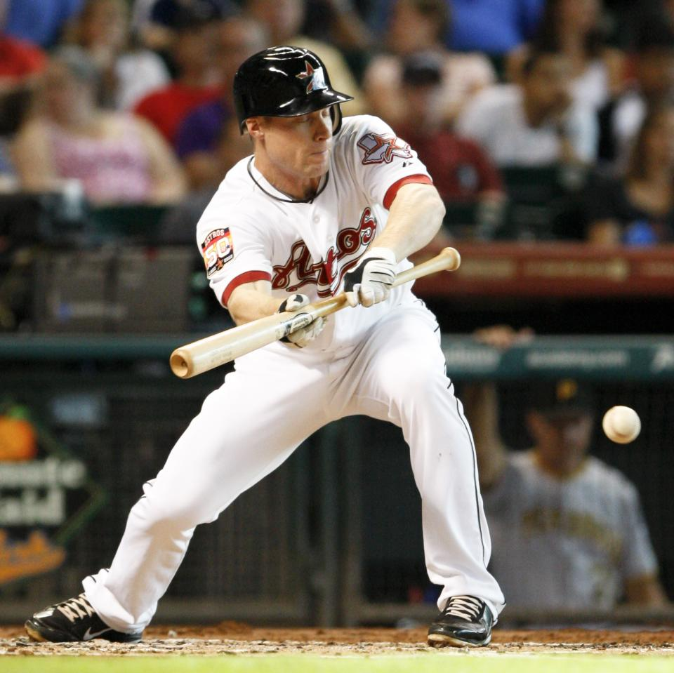 Houston Astro Brian Bixler (12) is out on a sacrifice bunt in the second inning of a baseball game against the Pittsburgh Pirates Saturday July 28, 2012 in Houston. (AP Photo/Eric Kayne)