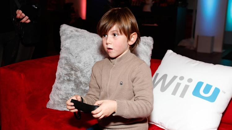 Actor Alexander James Rodriguez warms up and checks out Wii U at the Nintendo Lounge during a break from the Sundance Film Festival on Monday, Jan. 21, 2013 in Park City, Utah. (Photo by Todd Williamson/Invision for Nintendo/AP Images)
