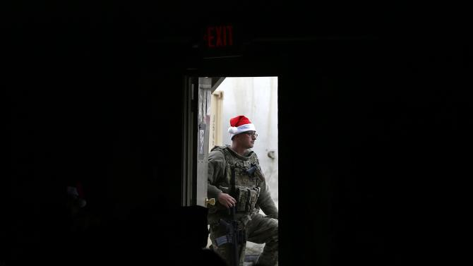 U.S. soldier from the Nato-led International Security Assistance Force stands guard during a Christmas day concert for U.S. military personnel at Bagram Airfield