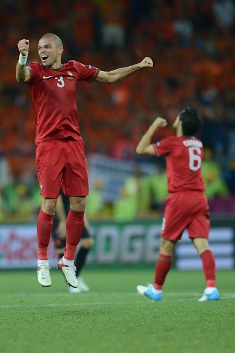 Portuguese Defender Pepe (L) Celebrates AFP/Getty Images
