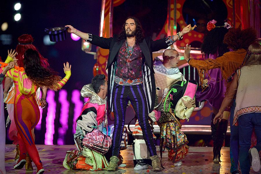 "Russell Brand squeezed his epic man-thighs into striped skinny pants, mixed a bunch of prints, and added a jacket with tails to recreate the Beatles' ""Seargant Pepper's Lonely Hearts Club Band"" album"
