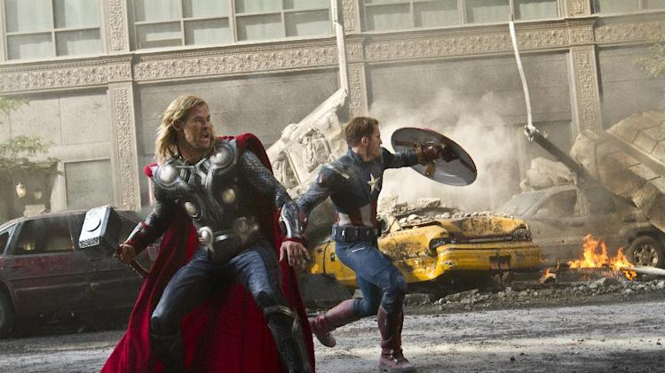 """FILE - In this publicity film image released by Disney, Chris Hemsworth portrays Thor, left, and  and Chris Evans portrays Captain America, in a scene from """"The Avengers,"""" expected to be released on May 4, 2012. (AP Photo/Disney, Zade Rosenthal, File)"""