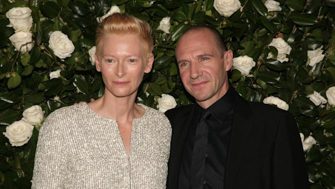Actress Tilda Swinton, left, and actor Ralph Fiennes, right, attend the the Museum of Modern Art Film Benefit on Tuesday, Nov. 5, 2013 in New York. (Photo by Andy Kropa/Invision/AP)