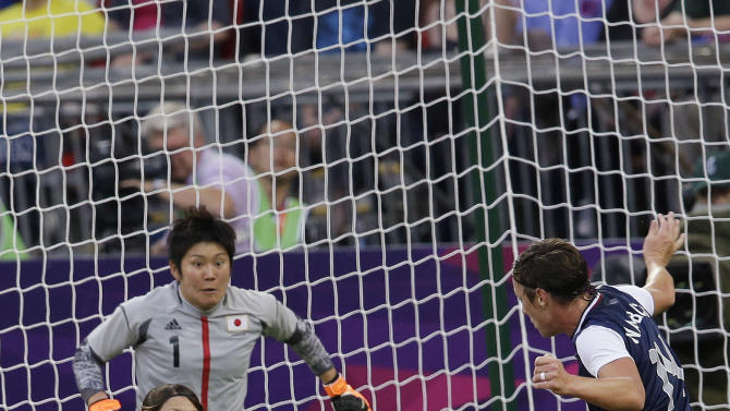 United States' Carli Lloyd (10) scores between Japan's Aya Sameshima (5) and  Nahomi Kawasumi (9) during the women's soccer gold medal match at the 2012 Summer Olympics, Thursday, Aug. 9, 2012, in London. (AP Photo/Andrew Medichini)