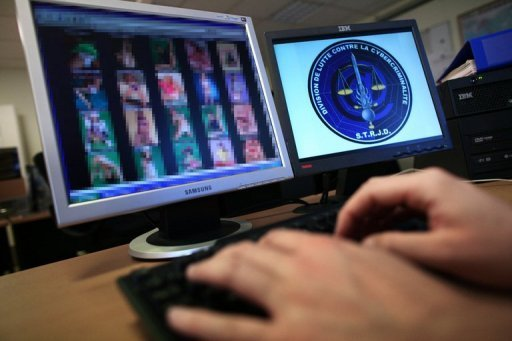 <p>File picture shows a police officer investigating a paedophile website. Hundreds of paedophiles prowling on the Internet have been identified in an operation in 141 countries, Austrian federal police said Wednesday.</p>