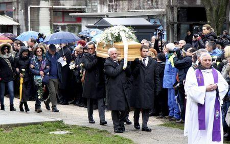 The coffin of Italian student Giulio Regeni is carried during his funeral in Fiumicello, Italy