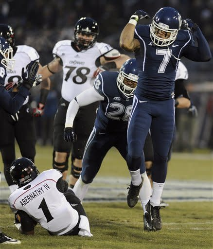 Kay, Kelce lead Cincinnati over UConn 34-17