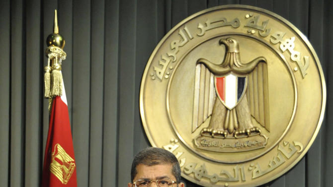 In this image released by the Egyptian Presidency, President Mohammed Morsi prepares to make a televised address to the nation in Cairo, Egypt, Wednesday, Dec. 26, 2012. Morsi says the new constitution establishes Egypt's new republic,  calling on opposition to join dialogue to heal rifts and shift the focus toward repairing the economy.(AP Photo/Egyptian Presidency)
