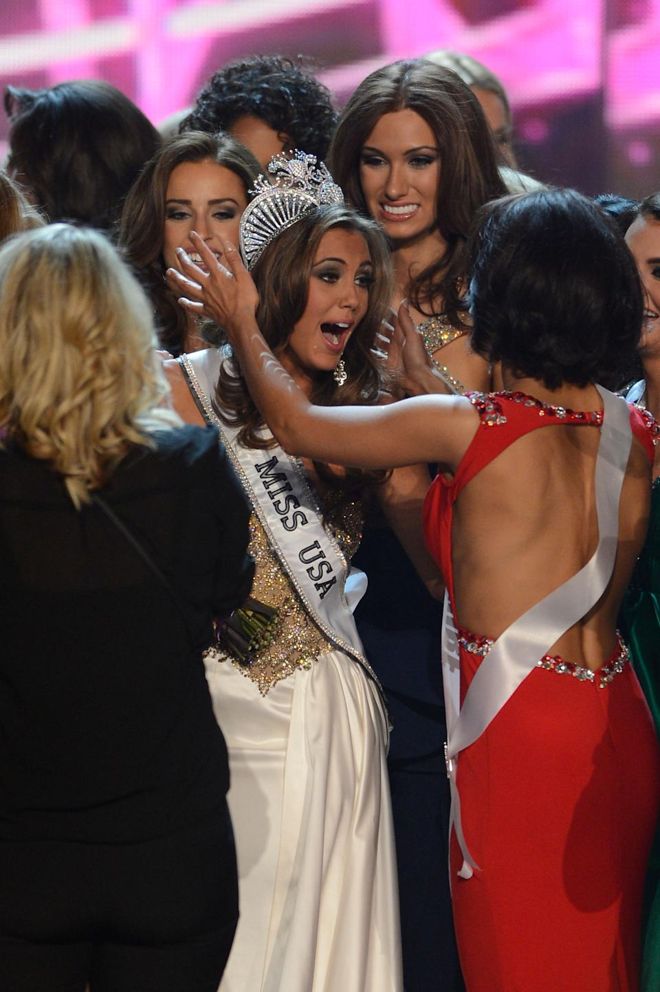 Miss Connecticut Erin Brady, center, reacts after winning the Miss USA 2013 pageant, Sunday, June 16, 2013, in Las Vegas. (AP Photo/Jeff Bottari)