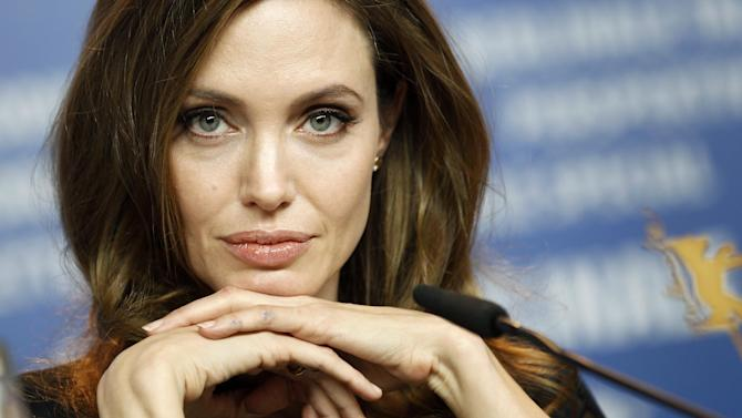 """FILE - In this Feb. 11, 2012 file photo, Angelina Jolie attends the news conference of the film """"In the Land of Blood and Honey"""" at the 62 edition of the Berlinale International Film Festival in Berlin. Walt Disney Studios announced, Wednesday, Aug. 22, 2012, that Angelina Jolie's youngest daughter, four-year-old Vivienne Jolie-Pitt, will play a """"minor role"""" as a young Princess Aurora, in the upcoming film, """"Maleficent.""""  Jolie plays the title character in the Disney film which is set to hit theaters in March of 2014. (AP Photo/Michael Sohn, File)"""