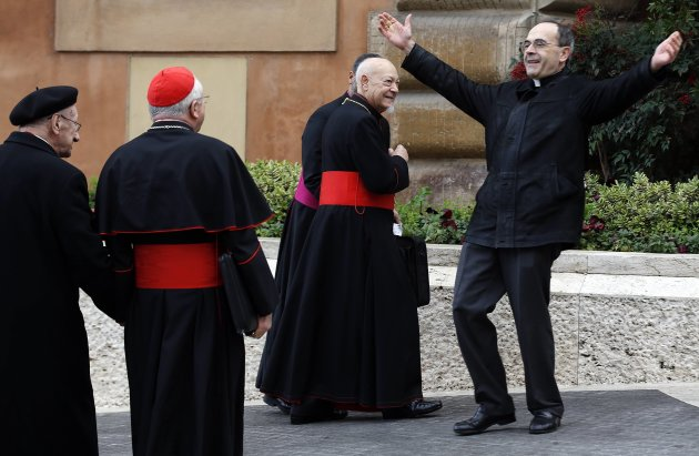 French Cardinal Barbarin reacts as he arrives for a meeting at the Synod Hall at the Vatican