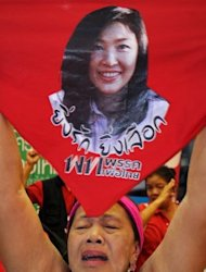 Supporters of Yingluck Shinawatra shout slogans at Puea Thai Party headquarters in Bangkok in 2011. Thailand&#39;s Constitutional Court on Friday heard evidence in a case centering on claims that plans by Prime Minister Shinawatra&#39;s party to amend the constitution are a threat to the deeply-revered monarchy